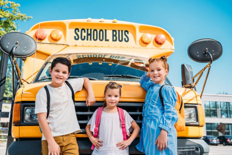kids in front of a school bus